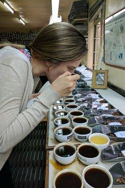 Kait tasting coffee in Kenya