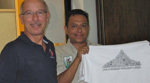 John Sacklin and a collaborator hold up a new interpretive shirt.