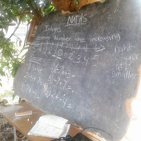 Teaching Grade 8 Math under the mango tree.