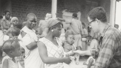 In 1965, PCV Art checks the weight of a Malawian baby.