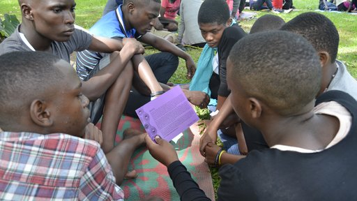 Campers ages 14-19 participating in a gender-based violence story telling and decision-making activity.