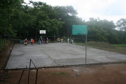 Completed multi-use court the community built with support from the high school, 50+ local volunteers and a group of 20 Courts for Kids volunteers from my hometown.