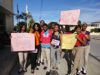 "This activity was ""Free Hugs Day,"" in which students and volunteer gave free hugs to community members and brochures to prevent violence and promote peace."