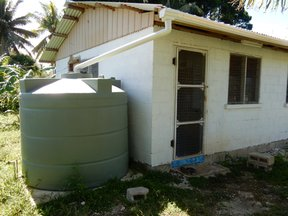 Volunteer house with water tank