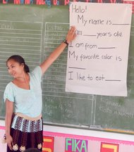 Trainee practices simple grammatical constructions in Model School during Pre-Service Training