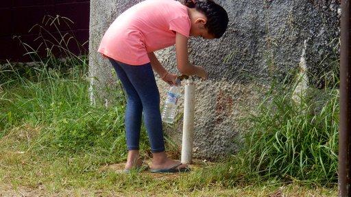 Taking a water break at the school water tank