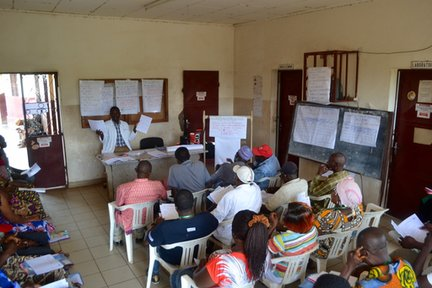 The doctor training teams on malaria related interventions.