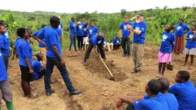 Peace Corps Volunteers David McHolland teaching permagarden digging to the Blue House girls_edited.jpg