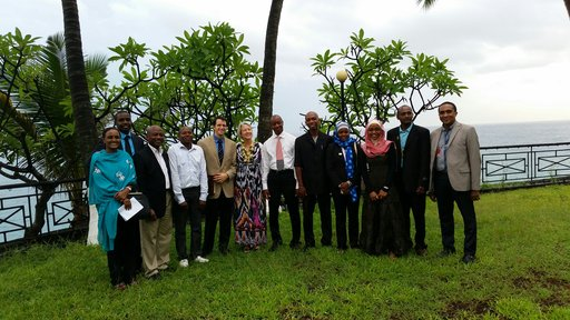 Director Carrie Hessler-Radelet visits with Peace Corps Comoros staff members, including Haina.