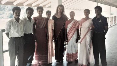 PCV dressed in saree the Professional standard attire for a female teacher posing with her counterpart males dressed in shirt