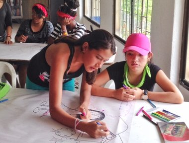 Girls learning about gender and leadership outside the traditional classroom.