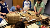 students examine objects from Tonga
