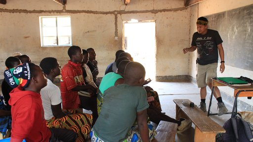 Education Volunteer Andrew teaches in a Malawian classroom.