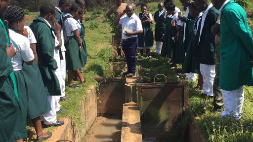 Community health nursing students visiting a sewage facility in Mzuzu, Malawi. These are first-year nursing students at St. John of God College of Health Sciences, where GHSP Volunteers are teaching.