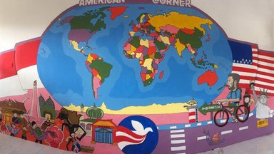 Colorful world map mural on wall of classroom
