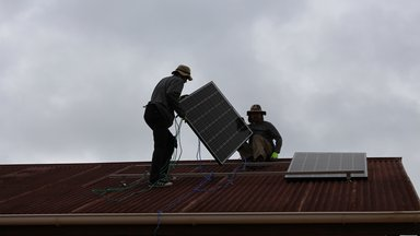 Solar Panel Being Installed on Roof