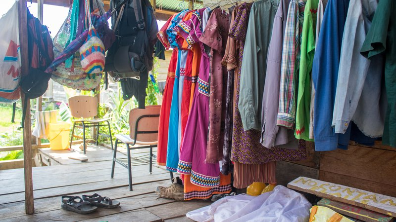 Colorful dresses hang on a line.