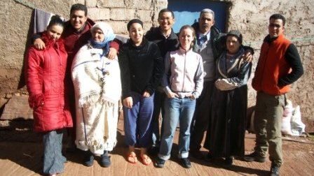 JK (5th from left) and Amanda (6th from left) with their phenomenal host family in Morocco.