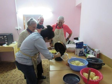 Some Volunteers learning how to make khachapuri (cheese-filled dough) and lobiani (bean-filled dough).