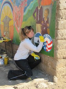Laura works on the Peace Corps mural.