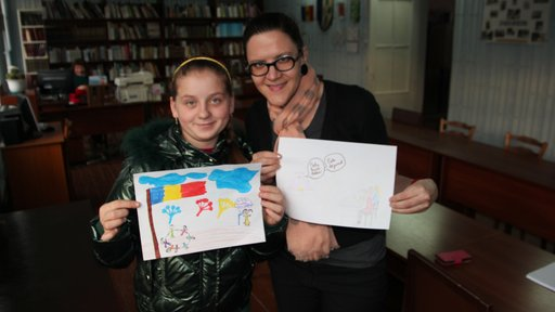 Local youth Cristina participates in an art hour, drawing pictures to share with Americans about Moldova.