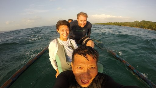 Morgan travels by boat to perform surveys of the local marine protected areas, with her coworkers Drew Sullivan (back, fellow Peace Corps Volunteer) and Romeo Pugoy Jr. (front).