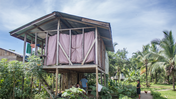 A wooden house on stilts in Panama