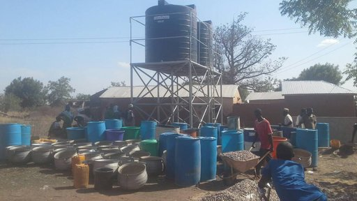 Clean water is piped from a nearby community and storied in two 10,000-liter tanks for consumption.
