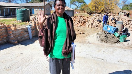 One of the nurses who decided not to retire when the new ward was built, standing on the foundation