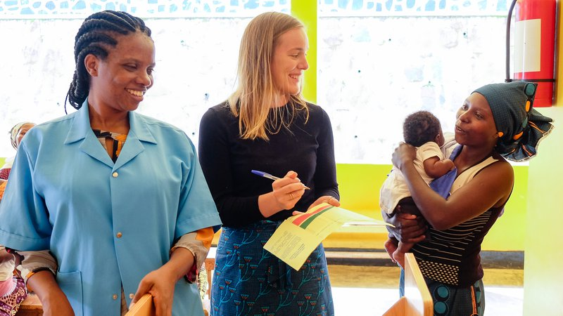 PCV Grace and counterpart collect and explain growth data to mother of baby