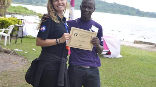 Volunteer Katie Fox awards a certificate to a camp participant.