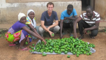 Peace Corps Volunteers Genevieve James and Ryan Ott introduced green peppers for the first time to a village in Ghana.