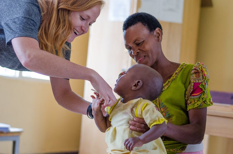 PCV Hannah measures the arm of a child