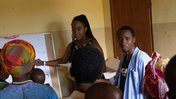 PCV Niesha and counterpart speak to mothers in milk group.