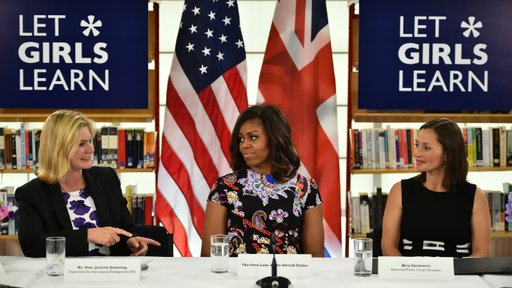 Participating in a roundtable discussion with First Lady Michelle Obama