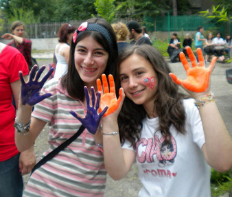 young girls with painted hands