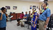 Steve Price and Deborah Buckley raise their right hands as they're sworn in as Peace Corps Response Volunteers in Samoa.