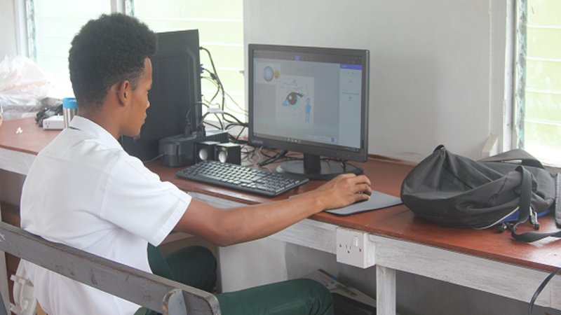 Linford Marks, the Hub Technician in training, practicing his program skills at the computer hub.
