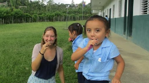 PCV Megan with child brushing their teeth.