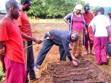 Mr. Benedict demonstrates how to sow seeds in a PermaGarden vegetable bed
