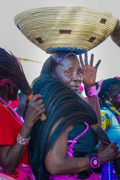 My Namibian mother bringing a gift on her head to the bride and groom.