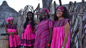 Clarice with her Namibian mother and sisters at their house.
