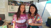 Wearing traditional Guatemalan outfits while serving coffee.