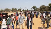 Emily Kroloff walks with community members in Zambia