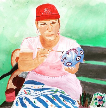 Abigail, an artisan and friend who paints piggy banks.