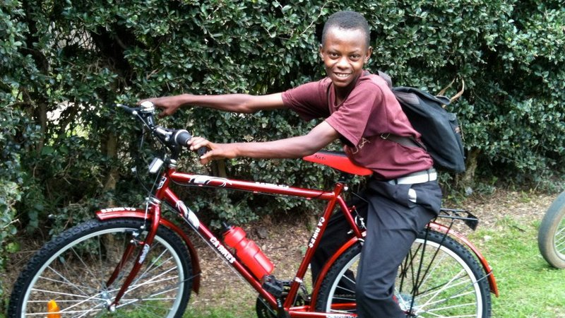 Tiffany Tai helped her organization distribute bikes to needy children.