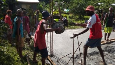 Community members proving man power for the building project