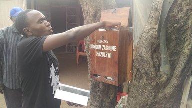 Edwin Filling the Condom Box