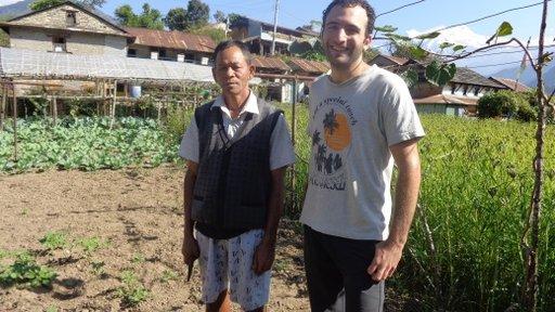 Elie with a model farmer