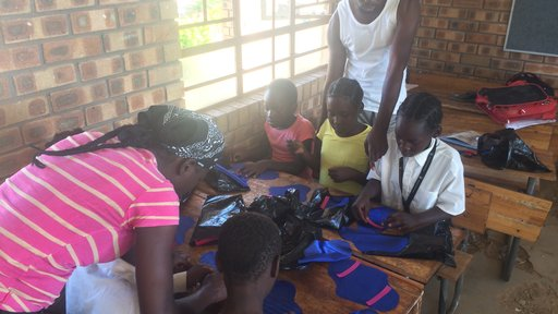 Child & youthcare workers help girls make RUMPs (reusable menstrual pads).